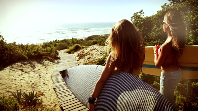 surfer girls high-five and go - surfboard stock videos & royalty-free footage
