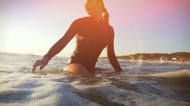 surfer girls in action - surfboard stock videos & royalty-free footage