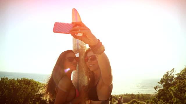 Surfer girls taking a selfie