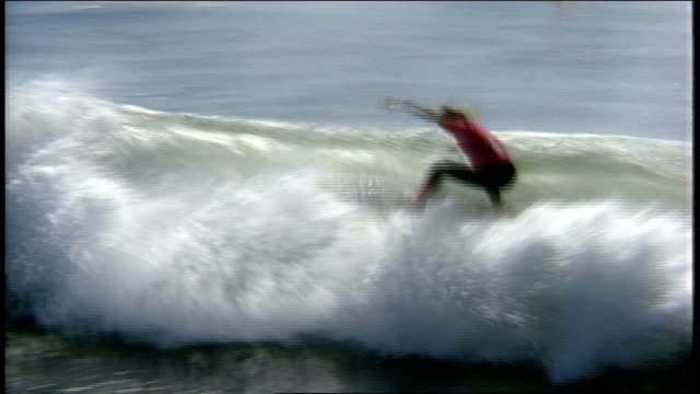 stockvideo's en b-roll-footage met surfer in wetsuit riding wave in santa cruz, california - 1980 1989