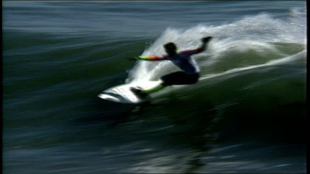 Surfer in White and Neon Yellow Riding Waves in Santa Cruz California