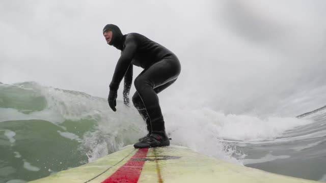 surfer on water in cold winter weather - mature men stock videos & royalty-free footage