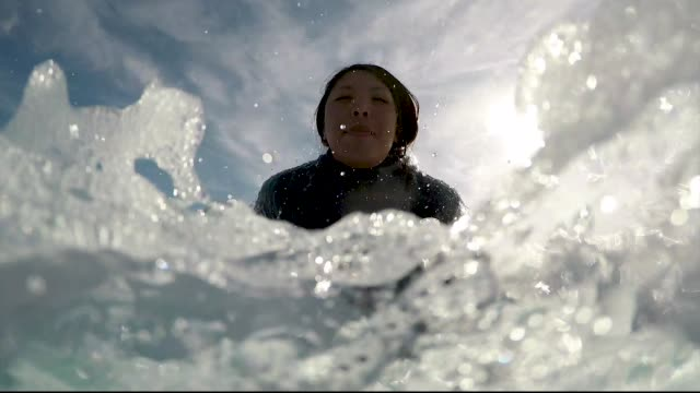 surfer on water in cold winter weather - surfboard stock videos and b-roll footage