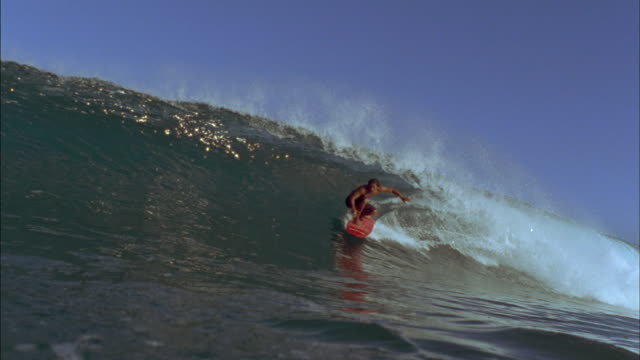 A surfer rides the pocket of a wave.