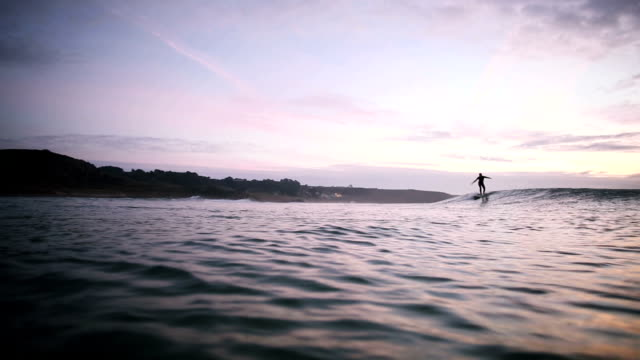 surfer rides wave with style - channel islands england stock videos & royalty-free footage