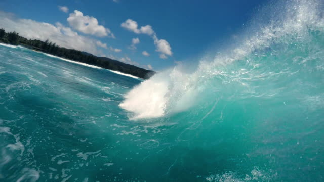 pov of surfer riding into the barrell of a wave - タートル湾点の映像素材/bロール