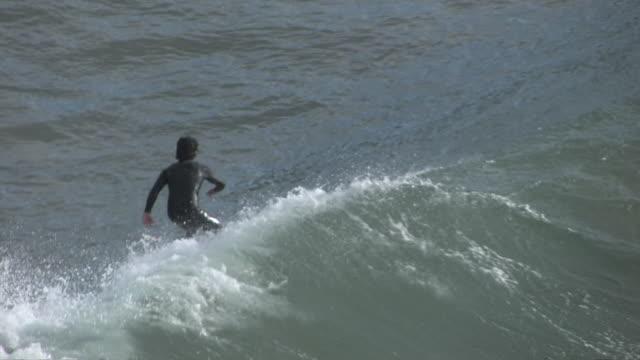 ms zo surfer surfing at point dume near paradise cove / malibu, california, united states - malibu stock videos & royalty-free footage
