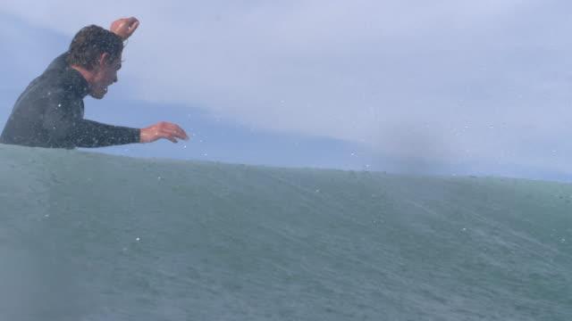 a surfer surfing waves on his classic longboard surfboard. - slow motion - santa barbara stock-videos und b-roll-filmmaterial