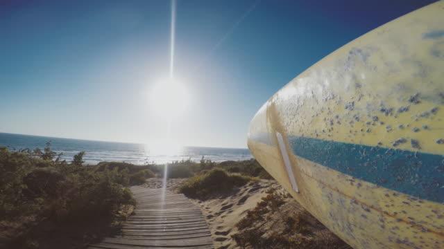 POV Surfer walk to the sea