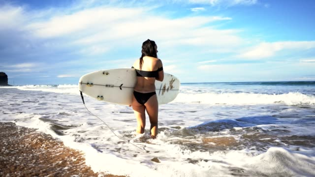 surfer walking on the beach - swimwear stock videos and b-roll footage