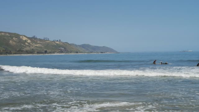 surfers at pacific coast near santa barbara, california, united states of america, north america - north pacific stock videos & royalty-free footage