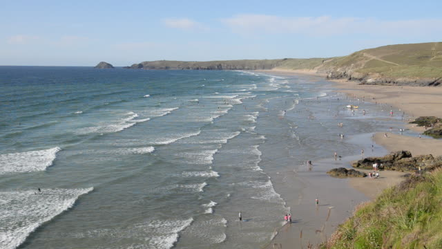 Surfers at Peran Bay, Newquay, Cornwall, UK