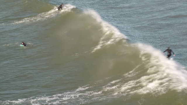 surfers in bridgend - water sport stock videos & royalty-free footage