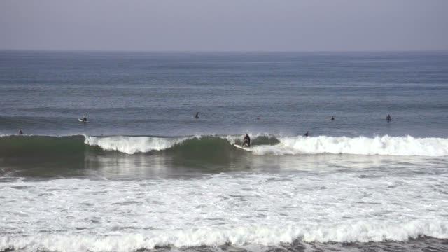 surfers in huntington beach - huntington beach california stock videos and b-roll footage