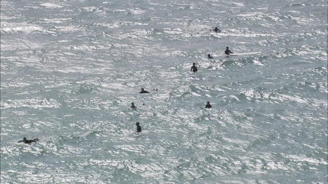 aerial ws surfers in ocean, off west coast of parque natural de sintra-cascais / cascais, lisbon, portugal - cascais stock videos and b-roll footage