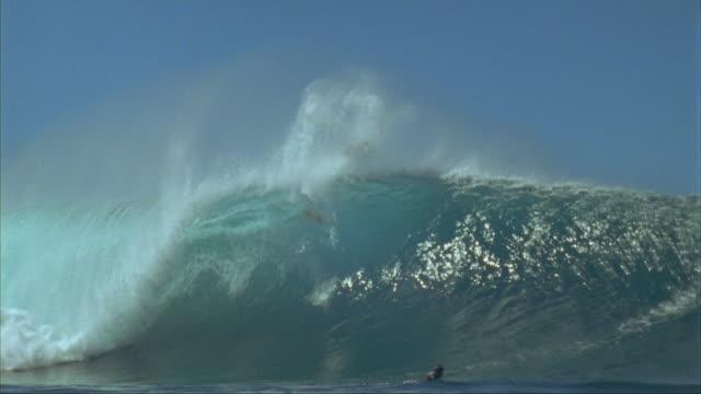 SLO MO, WS, Surfers in ocean waves, Oahu's North Shore, Hawaii, USA