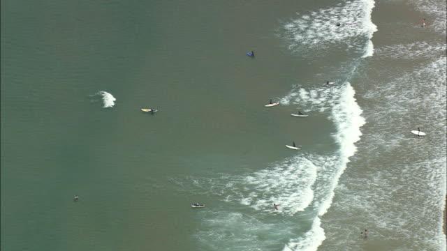 aerial ws surfers in sea / cascais, lisbon, portugal - cascais stock videos and b-roll footage