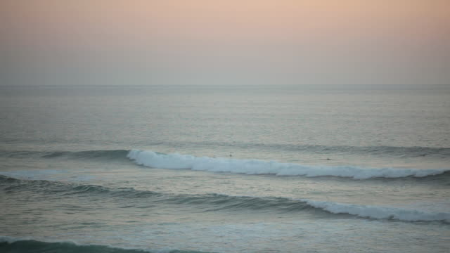 Surfers in the waves in southern France / Soulac-sur-Mer, Aquitaine, France