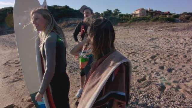Surfers on the beach 4K