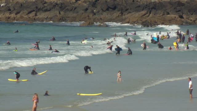 surfers on the cornwall coast at st ives - recreational pursuit stock videos & royalty-free footage