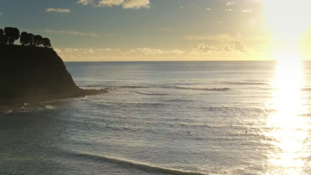 surfers on the waves at sunset - aerial - palos verdes stock videos & royalty-free footage