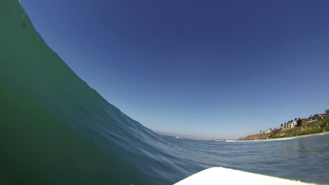 surfer's point of view - curled up stock videos and b-roll footage