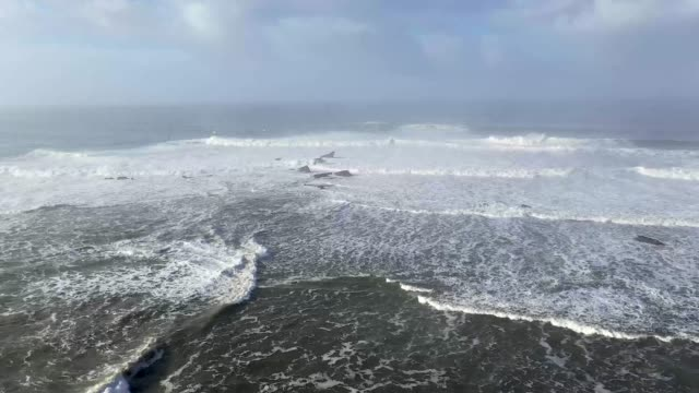 Surfer's rides waves at Mavericks Half Moon Bay on December 17 2018 in Half Moon Bay California A giant swell brought waves of up to 50 feet high to...