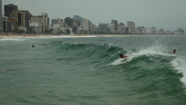 Surfers surfing in the waves