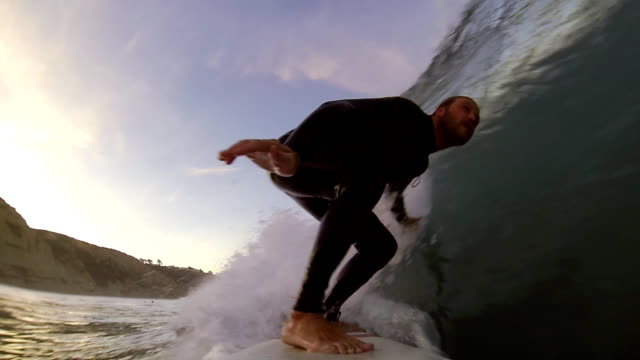 surfing at sunrise - curled up stock videos and b-roll footage