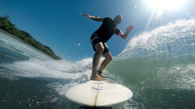 surfing in costa rica - surfboard stock videos & royalty-free footage