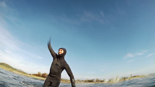 surfing pov with action camera: entering - greeting stock videos & royalty-free footage