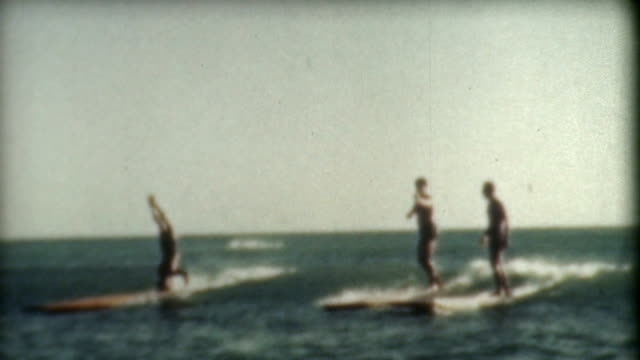 surfing tricks 1930's - hawaii islands stock videos & royalty-free footage