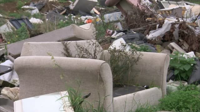 surge in flytipping across england england ext various shots of flytipped rubbish including television furniture and mattress nigel pepper looking at... - rubbish dump stock videos & royalty-free footage