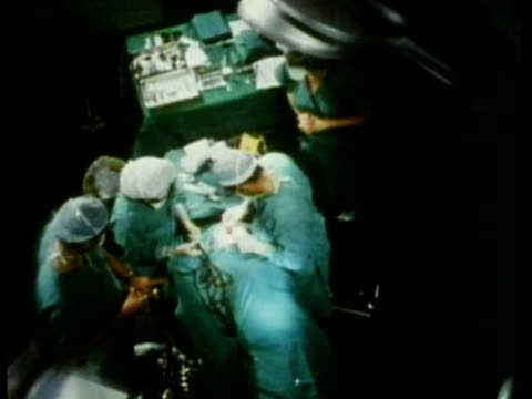 1969 ha ms zo surgeon and assistants completing ear surgery in operating theatre/ usa/ audio - operating theatre stock videos & royalty-free footage
