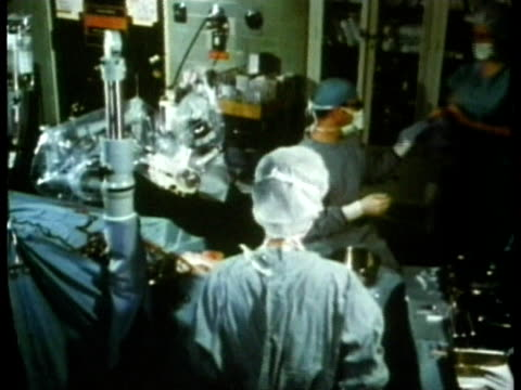 1969 ms ha zi surgeon and assistants in operating room preparing for stapedectomy procedure on patient/ usa/ audio - surgeon stock videos & royalty-free footage