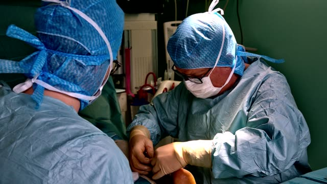 surgeon and his assistant operating - france stock videos & royalty-free footage