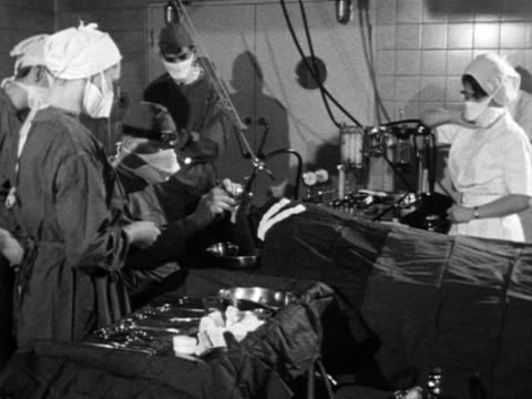 A surgeon and his team operate on a patient