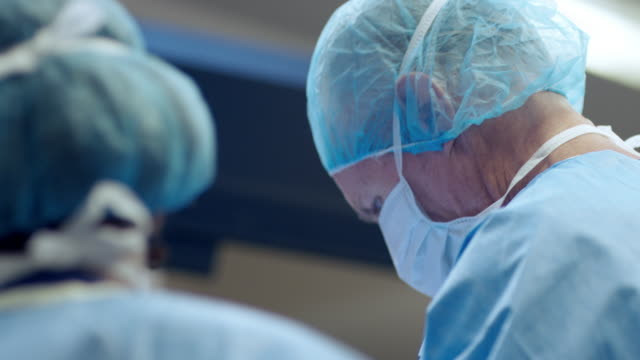 Surgeon and nurse in operating room