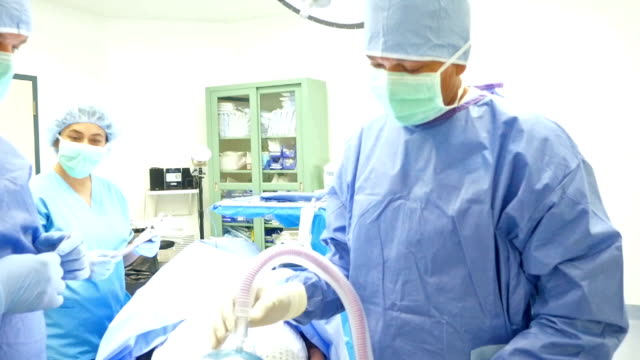 surgeon and nurses wait as anesthesiologist administers anesthesia - anaesthetist stock videos & royalty-free footage