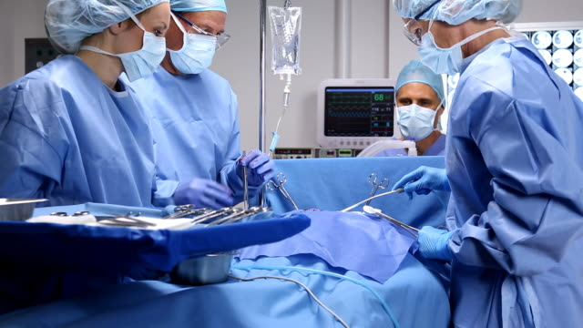 surgeon and team - operating theatre stock videos & royalty-free footage
