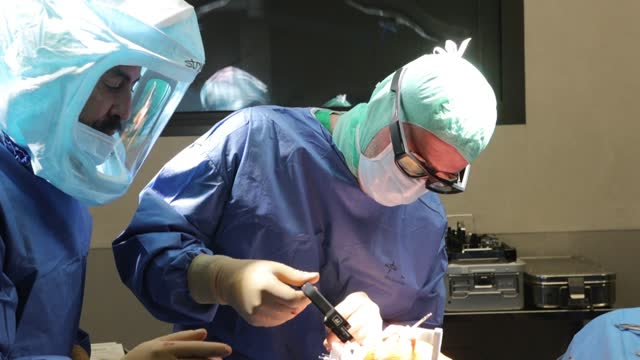 surgeon assisted by virtual reality glasses linked to a screen poses a knee prosthesis to a patient in the operating room of the saint roch clinic.... - cyberspace stock videos & royalty-free footage