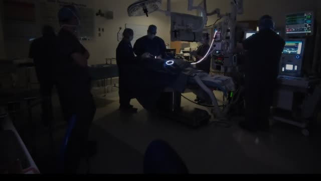 surgeon at work in silhouette. backlit and shot in documentary style, emergency feel, hand held. - anesthetic stock videos & royalty-free footage