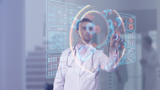 vídeos de stock, filmes e b-roll de surgeon doctor looking at futuristic medical charts at a high tech hospital - science and technology