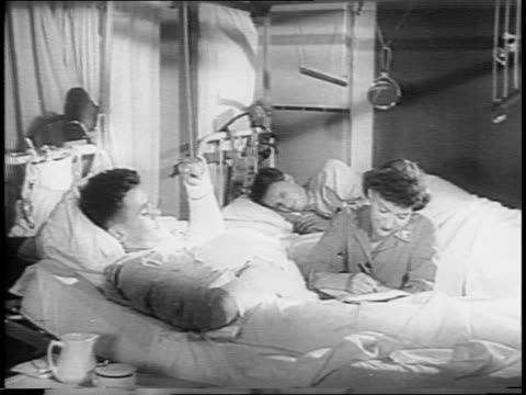 surgeon general norman t kirk and colonel oveta culp hobby, director us women's army corps seated / wacs at clerical files, medical equipment,... - militärisches landfahrzeug stock-videos und b-roll-filmmaterial