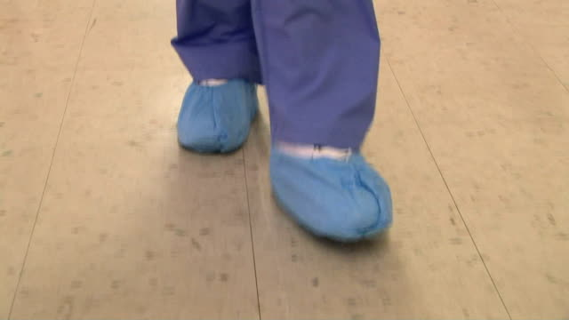 surgeon in hospital corridor - medical scrubs stock videos & royalty-free footage