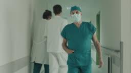 Surgeon walking in hospital