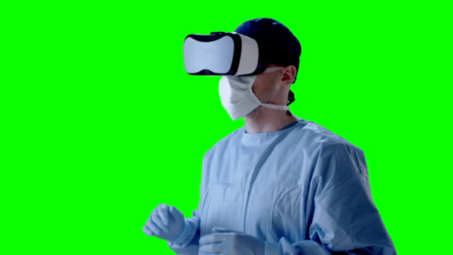 Surgeon wearing virtual reality glasses during medical research