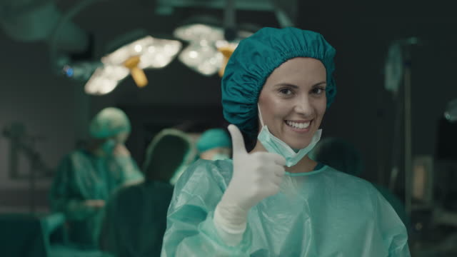 surgeon woman showing thumbs up gesture - agreement stock videos & royalty-free footage
