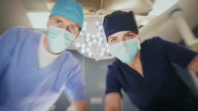 surgeons in operating room - waking up stock videos & royalty-free footage