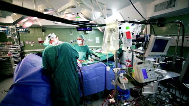 surgeons in operating room - operating stock videos & royalty-free footage